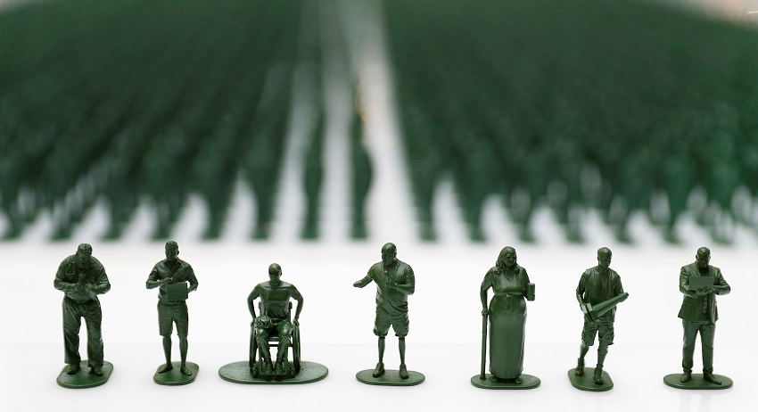 plastic figures of seven medically discharged veterans reuters.JPG