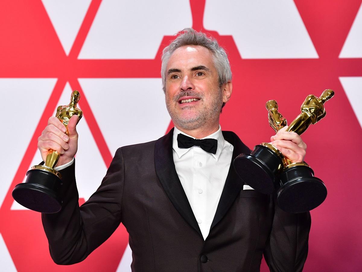 """جائزة الأوسكار في الإخراج لأفضل فيلم بلغة أجنبية ذهبت إلى ألفونسو كوارون من المكسيك عن الفيلم السينمائي """"روما"""" (أ.ف.ب)"""