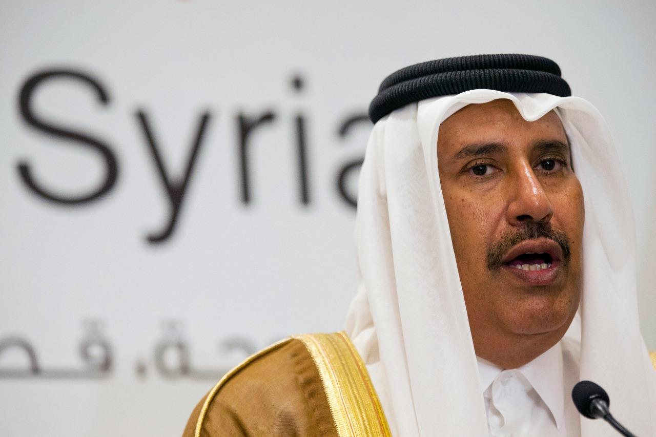 الشيخ حمد بن جاسم متحدثاً في مؤتمر صحفي بالدوحة عن سوريا 22 يونيو 2013 (أ.ف. ب.)