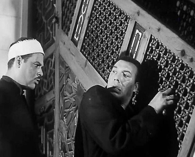 """فريد شوقي ويحيى شاهين في مشهد من فيلم """"جعلوني مجرماً"""" (موقع السينما.كوم)"""