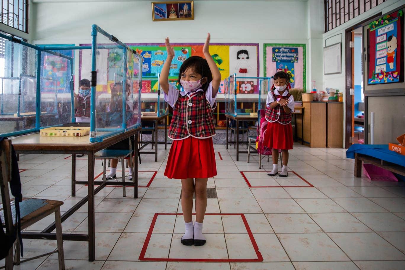إجراءات أمان مشددة حتى في دور حضانة تايلاندا لمواجهة كورونا (غيتي)