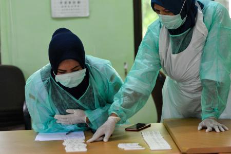 لا تزال دول العالم تسجل ارتفاع في عدد مصابي الفيروس التاجي (أ.ف.ب).jpg