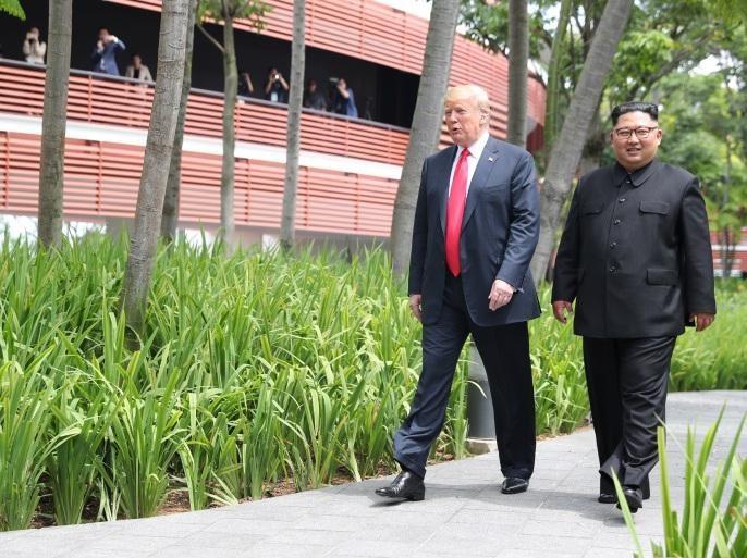 مع رئيس كوريا الشمالية (رويترز).jpg