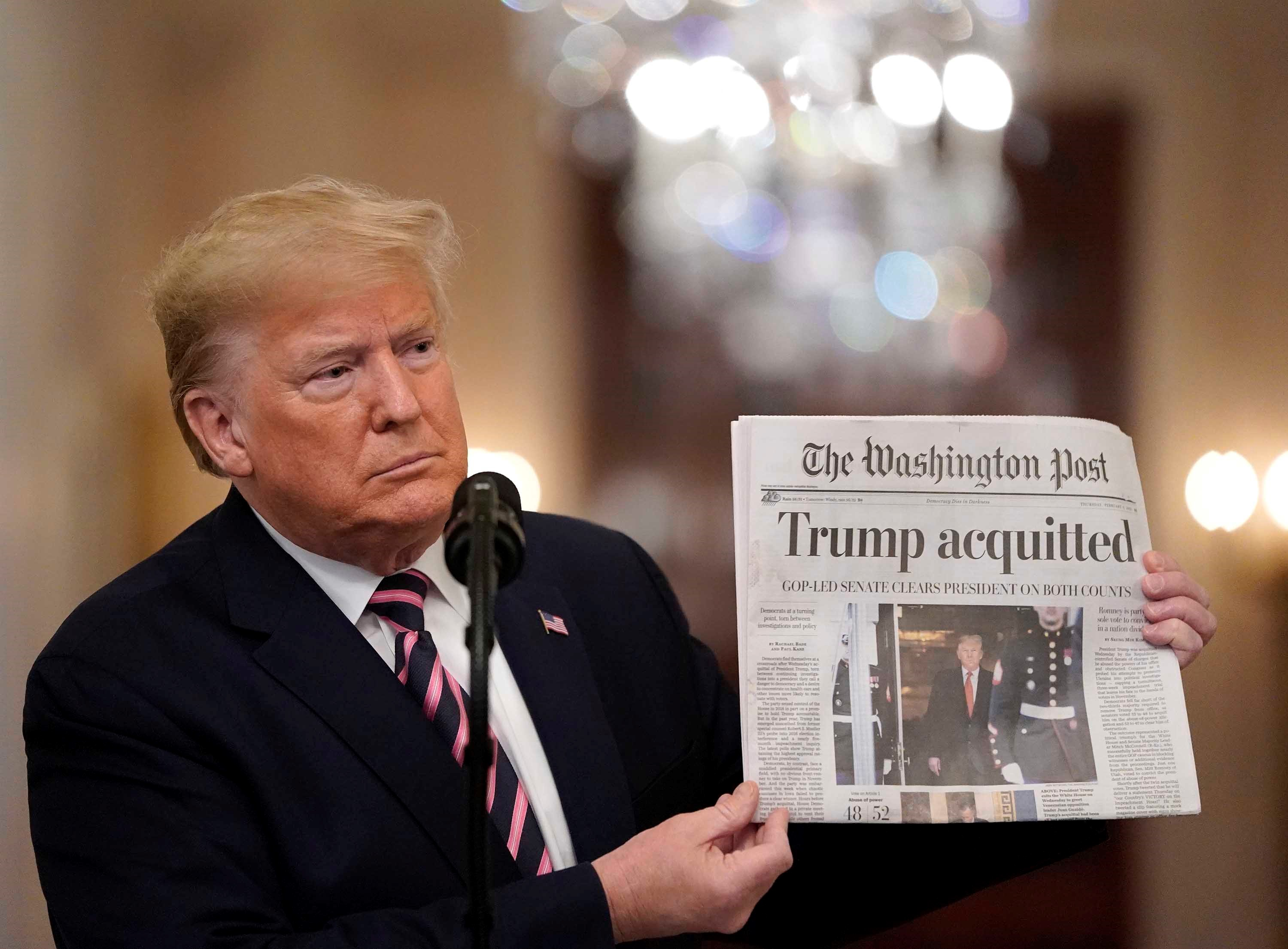 ترمب بريء عنوان واشنطن بوست الذي لوح به الرئيس بعد فشل محاولة عزله. (غيتي).jpg