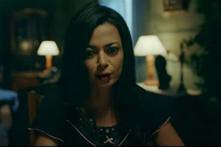 داليا مصطفى في مشهد من الفيلم.png