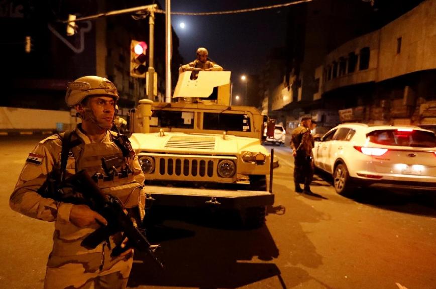 عسكريون اميركيون-مطار بغداد.png